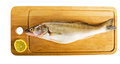 Pike perch on a wooden kitchen board Royalty Free Stock Photos