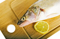 Pike perch on a wooden kitchen board Royalty Free Stock Images