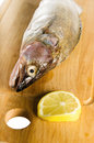 Pike perch on a wooden kitchen board Royalty Free Stock Photography