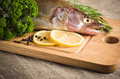 Pike perch on a wooden kitchen board Royalty Free Stock Image