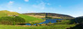 Pikehead farm above woodhead reservoir with a road in distance peak district uk panorama Royalty Free Stock Image