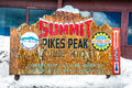 Pikes peak summit classic wood signage sign found at the top of pike s that showcases the altitude of feet making it the highest Royalty Free Stock Photos