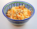 Pilaf in ceramic bowl Stock Photography