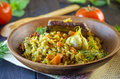 Pilaf on a platter with meat and spices Royalty Free Stock Photo
