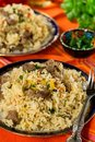 Pilaf style rice and lamb with carrots and garlic Royalty Free Stock Photo