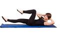 Pilates criss cross young female doing Stock Photos