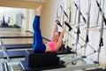 Pilates reformer woman back stroke exercise Royalty Free Stock Photo