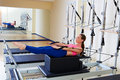 Pilates reformer woman back stroke exercise Royalty Free Stock Photo