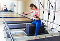 Pilates reformer woman short box horse back Royalty Free Stock Photo