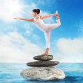 Pilates stone sea very flexible woman in a position Royalty Free Stock Photography