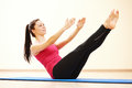 Pilates stretching fitness exercises young female instructor doing in sport club Royalty Free Stock Images