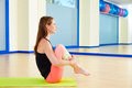 Pilates woman rolling like a ball exercise workout Royalty Free Stock Photo