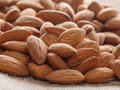 Pile of almonds close up as background closeup Stock Images