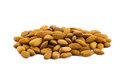 Pile of almonds a on a white background Stock Photos