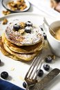 Pile of american pancakes with blueberries and powdered sugar. Royalty Free Stock Photo