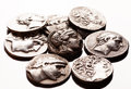 Pile of ancient greek coins on reflective surface Royalty Free Stock Photo