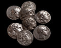 Pile of ancient silver greek coins top view Royalty Free Stock Photo