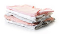 Pile of baby clothes isolated on white Royalty Free Stock Photo