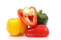Pile of bell peppers green yellow and red on white background with reflection Stock Image