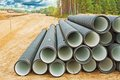 Pile of big water pipes on construction site Royalty Free Stock Photo