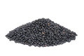 Pile Black Beluga Lentils isolated on white. Royalty Free Stock Photography