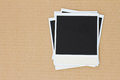Pile of blank instant photo on carton background Royalty Free Stock Photos