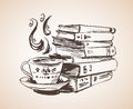 Pile of books with cup of tea.