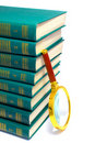 Pile of books and magnifier Royalty Free Stock Photography