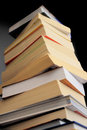 Pile of books tower on black background Royalty Free Stock Photo