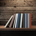 Pile of books on wooden shelf d render Royalty Free Stock Photo