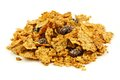 Pile of bran cereal flakes and raisins on a white background Stock Image
