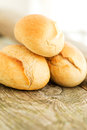 Pile of bread on wooden table close up round loafs Royalty Free Stock Photography