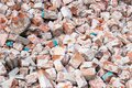 Pile of broken red bricks at construction site, waste. Abstract stone texture, rock background Royalty Free Stock Photo