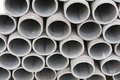 Pile of cement pipes on building materials warehouse Royalty Free Stock Photo