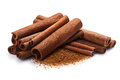 Pile of cinnamon in sticks and ground, paths Royalty Free Stock Photo
