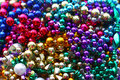 Pile of colorful beads a close up a rainbow colored shiny marti gras bead necklaces Royalty Free Stock Photography