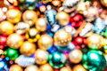 Pile of colorful christmas balls with blurred background Stock Photos
