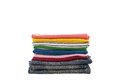 Pile of colorful clothes isolated on white background. Royalty Free Stock Photo