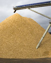 Pile of crushed stone mixed with sand golden from industrial conveyor belt Stock Photography