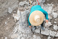 Pile cut off a construction worker cuts a concrete bored at s level Royalty Free Stock Photos