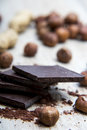Pile of dark chocolate with nuts and nutshells Royalty Free Stock Photo