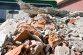 Pile of debris close up construction on structural delivery car Stock Photos
