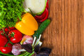 Pile of delicious useful vegetables on a wooden napkin Stock Image