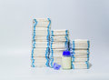 Pile of diapers and baby bottles on white background. Royalty Free Stock Photo