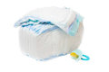 The pile of diapers and baby's dummy Royalty Free Stock Image