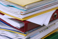 Pile of different file folders or ring binders full with office documents Royalty Free Stock Photo