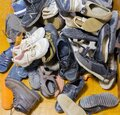 Pile of different mens and womens old worn footwear Royalty Free Stock Photo