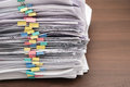 Pile of documents with colorful clips on desk stack up Royalty Free Stock Photos