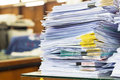 Pile of documents with colorful clips on desk stack up Stock Photography