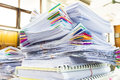 Pile of documents with colorful clips on desk stack up Royalty Free Stock Photography